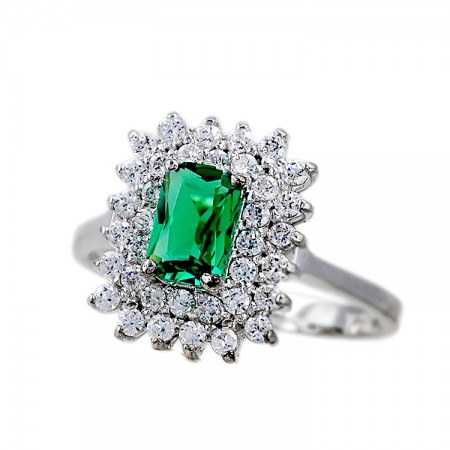 Ring in 14K whitegold with synthetic Emerald and zircon.